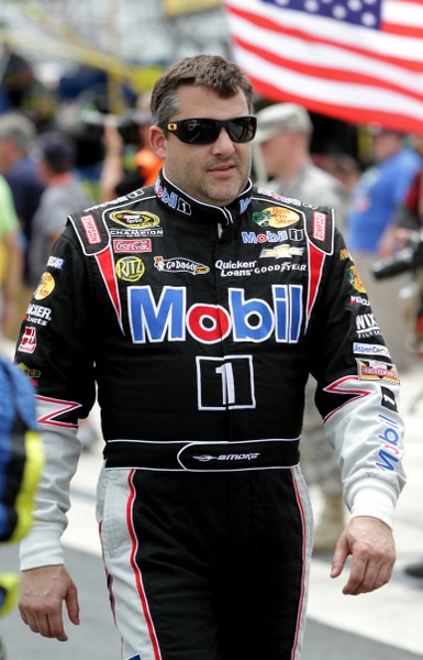 Grumpy Tony Stewart: a lot on his plate. Was the Dover win some Big Mo?