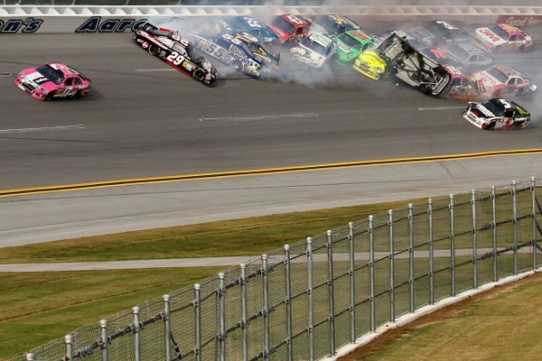 Tony Stewart triggers a huge last lap crash, and Matt Kenseth slips through to win a wild Talladega 500